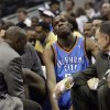 INJURY / INJURED: Oklahoma City Thunder guard Kevin Durant (35) holds his leg after injuring himself against the Dallas Mavericks during an NBA basketball game in Dallas, Friday, Feb. 27, 2009. Durant left the game. (AP Photo/LM Otero) ORG XMIT: DNA102