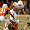 Fozzy Whittaker (28) of Texas tries to escape Jamie Blatnick (50) and Lucien Antoine (31) of OSU during the college football game between the Oklahoma State University Cowboys (OSU) and the University of Texas Longhorns (UT) at Boone Pickens Stadium in Stillwater, Okla., Saturday, Oct. 31, 2009. Photo by Doug Hoke, The Oklahoman