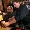 Oklahoma City Thunder Head Coach Scott Brooks gets help from bartender Ashley Brooks (no relation)as he works behind the bar at Bricktown Brewery in Oklahoma City on Tuesday, May 5, 2009. Scott Brooks\' tips will go to people who suffered losses during the Midwest City and Choctaw wildfires.Photo by John Clanton, The Oklahoman