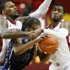 Oklahoma\'s Romero Osby (24), left, and Steven Pledger (2) pressure TCU\'s Charles Hill Jr. (0) during an NCAA men\'s basketball game between the University of Oklahoma (OU) and Texas Christian University (TCU) at the Lloyd Noble Center in Norman, Okla., Monday, Feb. 11, 2013. Photo by Nate Billings, The Oklahoman