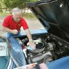 Fred Benenati cleans the motor of a 1966 Corvette during the 11th annual car show, part of the LibertyFest celebration at Hafer Park in Edmond, OK, Saturday, June 29, 2013, Photo by Paul Hellstern, The Oklahoman