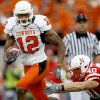 Adarius Bowman of OSU runs past Lance Brandenburgh of Nebraska during the college football game between Oklahoma State University (OSU) and the University of Nebraska at Memorial Stadium in Lincoln, Neb., on Saturday, Oct. 13, 2007. By Bryan Terry, The Oklahoman