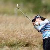Photo - Spain's Beatriz Recari plays her shot from the rough on the 11th fairway during the third day of the Women's British Open golf championship at the Royal Birkdale Golf Club, in Southport, England, Saturday, July 12, 2014. (AP Photo/Scott Heppell)