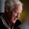 Hockey great Gordie Howe watches the Vancouver Canucks and San Jose Sharks play during an NHL hockey game in Vancouver, British Columbia, on Thursday Nov. 14, 2013. (AP Photo/The Canadian Press, Darryl Dyck)