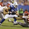 Photo - Indianapolis Colts' Donald Brown (31) is tackled buy Kansas City Chiefs' Derrick Johnson (56) during the second half of an NFL wild-card playoff football game Saturday, Jan. 4, 2014, in Indianapolis. (AP Photo/Michael Conroy)
