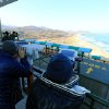 South Koreans use binoculars to look at Diamond Mountain in North Korea after news broke of North Korea\'s rocket launch at the Unification Observation post in Goseong, South Korea, Wednesday, Dec. 12, 2012. North Korea successfully fired a long-range rocket on Wednesday, defying international warnings as the regime of Kim Jong Un took a big step forward in its quest to develop a nuclear missile. (AP Photo/Yonhap, Lee Jong-gun) KOREA OUT ORG XMIT: SEL805