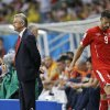 Photo - Switzerland's Haris Seferovic (9) walks past his coach Ottmar Hitzfeld after France scored their fifth goal during the group E World Cup soccer match between Switzerland and France at the Arena Fonte Nova in Salvador, Brazil, Friday, June 20, 2014. (AP Photo/Natacha Pisarenko)