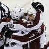 Colorado Avalanche\'s John Mitchell,right, is congratulated by teammates after his goal off Minnesota Wild goale Niklas Backstrom of Finland in the first period of an NHL hockey game Saturday, Jan. 19, 2013 in St. Paul, Minn. (AP Photo/Jim Mone)