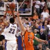 KU COLLEGE BASKETBALL: University of Kansas\' Wayne Simien (23) shoots the last shot of the game as Bucknell\'s Chris McNaughton (32) defends in the first round of the NCAA Tournament at the Ford Center in Oklahoma City, March 18, 2005. Bucknell won, 64-63, after Simien missed the shot. By Nate Billings.