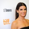 "FILE - In this Sept. 8, 2013 file photo, actress Sandra Bullock arrives at the premiere of ""Gravity"" on day 4 of the Toronto International Film Festival at The Princess of Wales Theatre, in Toronto. Bullock says making the lost-in-space movie ""Gravity"" with director Alfonso Cuaron was her ""best life decision"" ever. The film releases in US theatres Friday, Oct. 4, 2013. (Photo by Chris Pizzello/Invision/AP, File)"