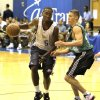 Thunder guard Kyle Weaver makes a move around Boston\'s Jaycee Carroll during Monday\'s summer league game. AP PHOTO