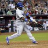 Photo - Los Angeles Dodgers' Yasiel Puig connects for a base hit against the Arizona Diamondbacks during the seventh inning of a baseball game Friday, May 16, 2014, in Phoenix. (AP Photo/Matt York)