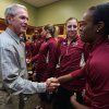 Former President George W. Bush shakes hands with Florida State\'s Morgan Tolels, right, and as Leonor Rodriquez watches before their second-round game against Baylor in the NCAA women\'s college basketball tournament, Tuesday, March, 26, 2013, in Waco, Texas. (AP Photo/Rod Aydelotte, Pool)