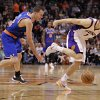 Photo - New York Knicks' Steve Novak, left, and  Phoenix Suns' Goran Dragic (1), of Slovenia, chase down a loose ball during the first half of an NBA basketball game on Wednesday, Dec. 26, 2012, in Phoenix. (AP Photo/Matt York)