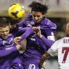 Photo - Fiorentina's Josep Ilicic, left, and Alberto Aquilani, center, fight for the ball with Livorno's Leandro Rinaudo during a Serie A soccer match at the Artemio Franchi stadium in Florence, Italy Sunday  Jan. 5, 2014. (AP Photo/Fabrizio Giovannozzi)