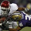 Oklahoma\'s Mossis Madu (17) is brought down by Washington\'s Johri Fogerson (36) during the second half of the college football game between the University of Oklahoma Sooners (OU) and the University of Washington Huskies (UW) at Husky Stadium on Saturday, Sep. 13, 2008, in Seattle, Wash. by Chris Landsberger, The Oklahoman