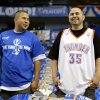 Photo - Twins Jose, left, and Ruben Campos of Fort Worth, Texas, talk before game 1 of the Western Conference Finals in the NBA basketball playoffs between the Dallas Mavericks and the Oklahoma City Thunder at American Airlines Center in Dallas, Tuesday, May 17, 2011. Photo by Bryan Terry, The Oklahoman