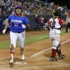 Florida\'s Lauren Haeger reacts as she scores past Nebraska\'s Taylor Edwards in the fifteenth inning during the Women\'s College World Series softball game between Nebraska and Florida at ASA Hall of Fame Stadium in Oklahoma City, Saturday, June, 1, 2013. Photo by Bryan Terry, The Oklahoman