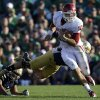 Oklahoma\'s Blake Bell (10) runs out of the tackle of Notre Dame \'s Dan Fox during the second half of an NCAA college football game on Saturday, Sept. 28, 2013, in South Bend, Ind. Oklahoma defeated Notre Dame 35-21. (AP Photo/Darron Cummings) ORG XMIT: INDC118
