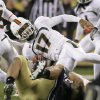 Miami quarterback Stephen Morris (17) is tackled by Notre Dame linebacker Manti Te\'o during the second half of an NCAA college football game at Soldier Field, Saturday, Oct. 6, 2012, in Chicago. (AP Photo/Nam Y. Huh)