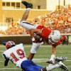OSU\'s Charlie Moore (17) is tripped up by Savannah State\'s Jovante Miller (19) during a college football game between Oklahoma State University (OSU) and Savannah State University at Boone Pickens Stadium in Stillwater, Okla., Saturday, Sept. 1, 2012. Photo by Nate Billings, The Oklahoman