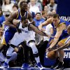 Dallas Mavericks center Bernard James (5) fights for a rebound against Golden State Warriors\' Draymond Green, top left, Andris Biedrins, second from right, and Jarrett Jack in the first half of an NBA basketball game, Monday, Nov. 19, 2012, in Dallas. (AP Photo/Tony Gutierrez)