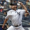 Photo - New York Yankees starting pitcher Vidal Nuno (57) delivers in the third inning of a baseball game against the Tampa Bay Rays at Yankee Stadium in New York, Wednesday, July 2, 2014.  (AP Photo/Kathy Willens)