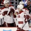 Phoenix Coyotes\' Michael Stone (26) is congratulated by his teammates after scoring a goal during the first period of an NHL hockey game against the Chicago Blackhawks in Chicago, Thursday, Nov. 14, 2013. (AP Photo/Nam Y. Huh)