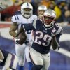 Photo - New England Patriots running back LeGarrette Blount (29) heads downfield for a touchdown during the second half of an AFC divisional NFL playoff football game against the Indianapolis Colts in Foxborough, Mass., Saturday, Jan. 11, 2014. (AP Photo/Matt Slocum)