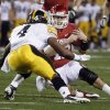Oklahoma\'s Landry Jones (12) is tackled by Iowa\'s Jordan Bernstine (4) during the Insight Bowl college football game between the University of Oklahoma (OU) Sooners and the Iowa Hawkeyes at Sun Devil Stadium in Tempe, Ariz., Friday, Dec. 30, 2011. Photo by Sarah Phipps, The Oklahoman