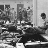 In this March 27, 1973 photo, surrounded by luggage of other departing GIs, U.S. Air Force airman reads paperback novel as he waits to begin processing at Camp Alpha on Saigon\'s Tan Son Nhut airbase in Saigon as troop withdrawals resume after 10 day-delay. More than 900 will leave with all U.S. troops out by Thursday. As the last U.S. combat troops left Vietnam 40 years ago, angry protesters still awaited them at home. North Vietnamese soldiers took heart from their foes\' departure, and South Vietnamese who had helped the Americans feared for the future. While the fall of Saigon two years later — with its indelible images of frantic helicopter evacuations — is remembered as the final day of the Vietnam War, Friday marks an anniversary that holds greater meaning for many who fought, protested or otherwise lived it. (AP photo/Charles Harrity)