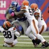 New York Giants running back Ahmad Bradshaw (44) is tackled by Cleveland Browns middle linebacker D\'Qwell Jackson (52), Craig Robertson (53) and Usama Young (28) during the first half of an NFL football game Sunday, Oct. 7, 2012, in East Rutherford, N.J. (AP Photo/Kathy Willens)