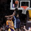 Photo -   Denver Nuggets' Kenneth Faried, right, blocks a shot by Los Angeles Lakers' Kobe Bryant during the second half of a NBA first-round playoff basketball game in Los Angeles, Tuesday, May 1, 2012. The Lakers won 104-100. (AP Photo/Chris Carlson)