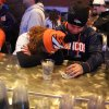 Photo - Denver Broncos fans Tatiana Bohorquez and Jorge Puerto look away from the TV while watching their team  fall behind the Seattle Seahawks during the second half of the Super Bowl, inside Jackson's, a sports bar and grill in Denver, Sunday, Feb. 2, 2014. The  Seahawks won 43-8. (AP Photo/Brennan Linsley)