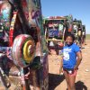 Photo - My youngest gets ready to get artistic at the Cadillac Ranch. Photo by Carla Meadows