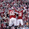 Photo -   Oklahoma wide receiver Jalen Saunders (18) celebrates with offensive lineman Bronson Irwin (68) after scoring a touchdown against Oklahoma State in the second quarter of an NCAA college football game in Norman, Okla., Saturday, Nov. 24, 2012. (AP Photo/Sue Ogrocki)