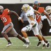 OSU\'s Herschel Sims (18) leaves behind Baylor\'s Mike Hicks (17) and Chance Casey (9) as well as OSU\'s Tracy Moore (87) on a touchdown run in the fourth quarter during a college football game between the Oklahoma State University Cowboys (OSU) and the Baylor University Bears (BU) at Boone Pickens Stadium in Stillwater, Okla., Saturday, Oct. 29, 2011. OSU won, 59-24. Photo by Nate Billings, The Oklahoman