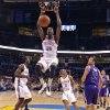 The Thunder\'s Kevin Durant (35) dunks the ball over the Kings\' Beno Udrih (19) during the NBA basketball game between the Oklahoma City Thunder and The Sacramento Kings on Tuesday, Feb. 15, 2011, Oklahoma City Okla. Photo by Chris Landsberger, The Oklahoman