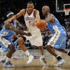 Oklahoma City\'s Russell Westbrook (0) tries to slip between the defense of Denver\'s Ty Lawson (3) , left, and Chauncey Billups (1) during the NBA basketball game between the Oklahoma City Thunder and the Denver Nuggets at the Ford Center in Oklahoma City, Friday, January 29, 2010. Oklahoma City won, 101-84. Photo by Nate Billings, The Oklahoman ORG XMIT: KOD