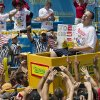 Joey Chestnut, now seven-time winner of the Nathan's Famous Fourth of July International Hot Dog Eating contest, is carried to the competition stage.