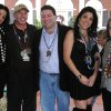 In this Jan. 30, 2010 photo, Natalie Khawam, left, Gen. David Petraeus, Scott and Jill Kelley, and Holly Petraeus watch the Gasparilla parade from the comfort of a tent on the Kelley\'s front lawn in Tampa, Fla. Jill Kelley is identified as the woman who received threatening emails from Gen. David Petraeus\' paramour, Paula Broadwell. Jill Kelley serves as the State Department\'s liaison to the military\'s Joint Special Operations Command. (AP Photo/The Tampa Bay Times, Amu Scherzer) TAMPA OUT; CITRUS COUNTY OUT; PORT CHARLOTTE OUT; BROOKSVILLE HERNANDO TODAY OUT; USA TODAY OUT; TV OUT; NO WEB USE; MAGS OUT