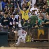 Photo - Minnesota Twins third baseman Trevor Plouffe falls down over the bullpen mound chasing a foul ball by Oakland Athletics' Daric Barton during the second inning of a baseball game Thursday, Sept. 19, 2013, in Oakland, Calif. (AP Photo/Marcio Jose Sanchez)