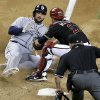Arizona Diamondbacks catcher Miguel Montero, right, tags out San Diego Padres\' Yonder Alonso at the plate during the fifth inning of a baseball game, Saturday, May 25, 2013, in Phoenix. (AP Photo/Matt York)
