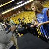 Photo - Oklahoma City's Serge Ibaka (9) signs an autograph for Thunder fan Maggie Turner of Cabot, Ark., before Game 4 of the second-round NBA basketball playoff series between the Oklahoma City Thunder and the Memphis Grizzlies at FedExForum in Memphis, Tenn., Monday, May 13, 2013. Photo by Nate Billings, The Oklahoman