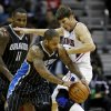 Orlando Magic\'s Jameer Nelson, left, dribbles against Atlanta Hawks\' Kyle Korver in the second quarter of an NBA basketball game, Monday, Nov. 19, 2012, in Atlanta. (AP Photo/David Goldman)