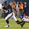 Photo - Chicago Bears fullback Tony Fiammetta (43) breaks away from New York Giants linebacker Keith Rivers (55) in the first half of an NFL football game, Thursday, Oct. 10, 2013, in Chicago. (AP Photo/Charles Rex Arbogast)