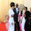 """Singer Rihanna, left, greets model Cara Delevingne, right, and actress Reese Witherspoon at The Metropolitan Museum of Art\'s Costume Institute benefit gala celebrating """"Charles James: Beyond Fashion"""" on Monday, May 5, 2014, in New York. (Photo by Evan Agostini/Invision/AP)"""