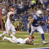 Photo - Indianapolis Colts' Donald Brown (31) makes a 10-yard touchdown run against the Kansas City Chiefs during the second half of an NFL wild-card playoff football game Saturday, Jan. 4, 2014, in Indianapolis. (AP Photo/Michael Conroy)