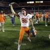 Photo - Clemson Tigers punter Andy Teasdall (95) celebrates after Clemson defeated Ohio State 40-35 the Orange Bowl NCAA college football game, Saturday, Jan. 4, 2014, in Miami Gardens, Fla. (AP Photo/Lynne Sladky)