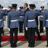 Photo -   U.S. President Barack Obama, center, walks down a red carpet through saluting military guards of honor as he arrives on Air Force One at Don Mueang International Airport in Bangkok, Thailand, Sunday, Nov. 18, 2012. (AP Photo/Carolyn Kaster)